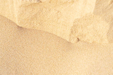 Sand on the beach for background. Brown beach sand texture as background. Close-up. 版權商用圖片