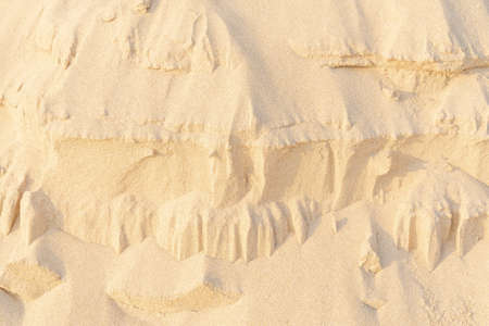 Sand on the beach for background. Brown beach sand texture as background. Close-up. 免版税图像