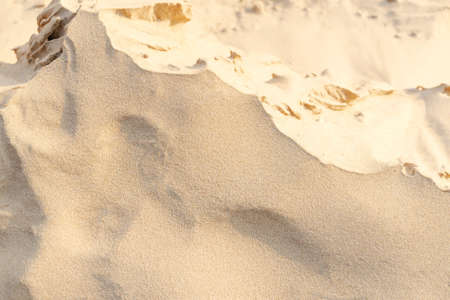 Sand pattern texture for background. Brown desert pattern from tropical beach. Close-up. Stockfoto