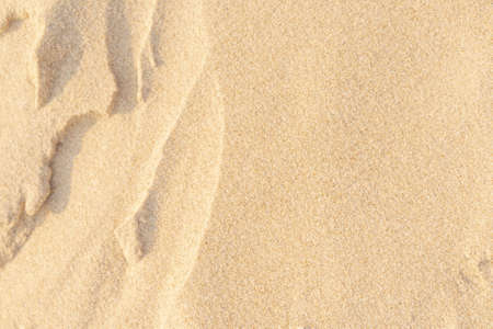 Sand texture background. Brown desert pattern from tropical beach. Close-up.