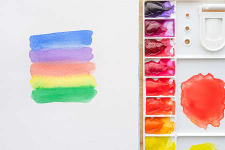 Watercolor paints in watercolor palette white paper. Bright multicolored aquarelle paints in paint box. Stockfoto