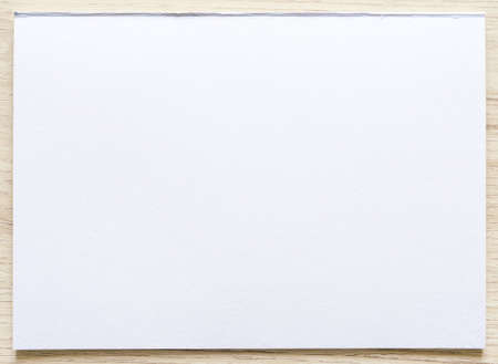 Watercolor paper texture on wood background with clipping path. White paper sheet with a torn edges. Art paper high quality texture in a high resolution. Standard-Bild