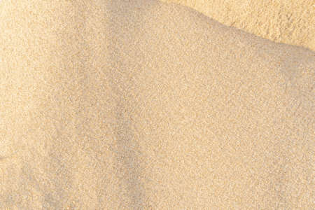 Sand texture background. Brown desert pattern on tropical beach. Close-up.