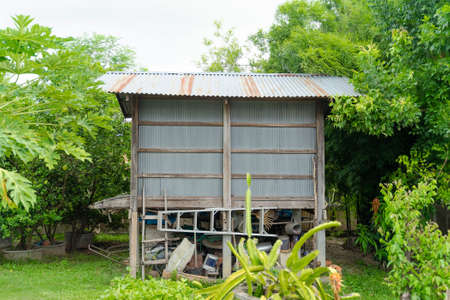 Rice barn for storage and drying of harvested rice in backyard area. In the northeastern of Thailand. Standard-Bild