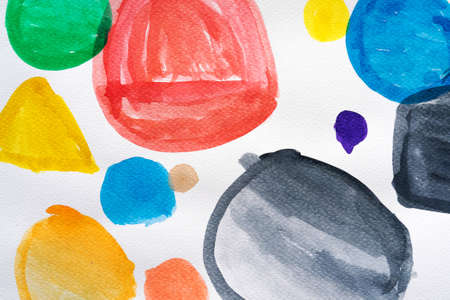 Watercolor hand painted circle shape design elements. Set of multicolored watercolor dots. Watercolor brush collection. Close-up.