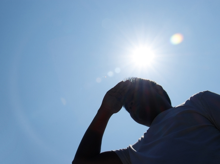 Young man and heat stroke. Stockfoto