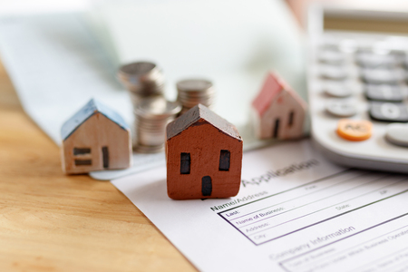 Home insurance form with money,passbook  and calculator.