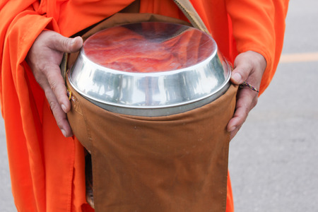 alms: Give alms to a Buddhist monk