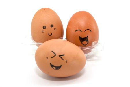 pareja comiendo: huevos divertidos con sentimiento cara. Foto de archivo