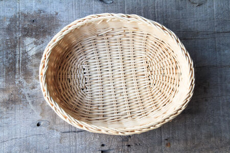bamboo basket on the wooden table photo