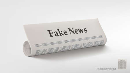 Rolled Newspaper With Big Title Fake News