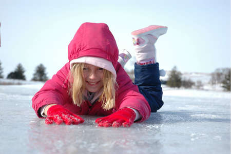 Young Girl Slides on Ice photo