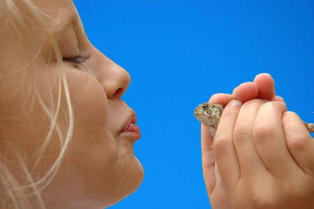 prince charming: Young Girl Prepares to Kiss Toad for Prince Charming
