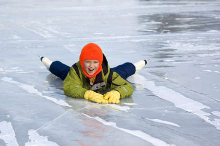 to stumble: Young Girl Falls Learning to Skate Stock Photo