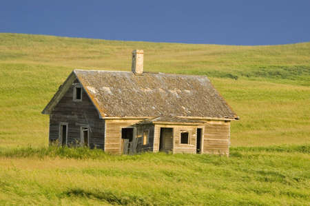 Old Abandoned Homestead on the Prairie photo