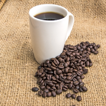hessian bag: Cup of coffee with coffee beans on hessian bag
