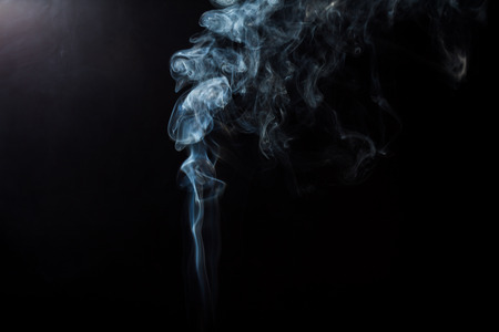 black smoke: Fluffy Puffs of Smoke and Fog on Black Background