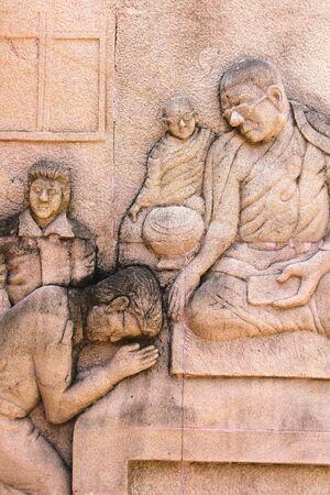 klerus: Sandsteinstatue des Klerus, thai Architektur in Loei, Thailand Lizenzfreie Bilder