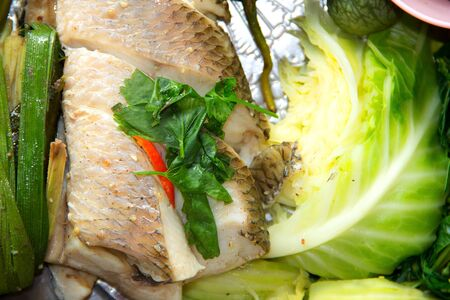 steamed freshwater fish with vegetables on a plate Stock Photo