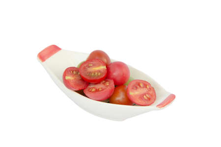 fresh tomatoes in bowl on white background