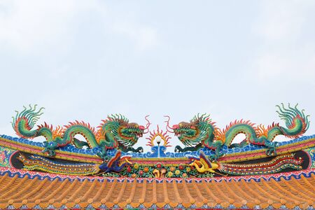 dragon statue on china temple roof as asian art photo