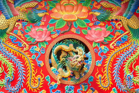 dragon statue on wall in chinese temple as asian art