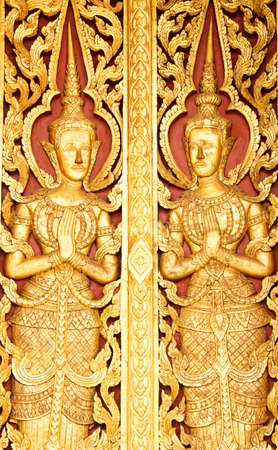 native Thai style carving, painting on church door in the temple Stock Photo - 13658510