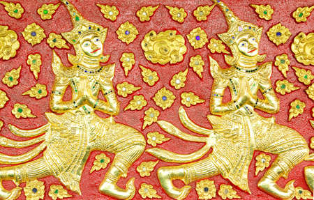 native Thai style carving, painting on church door in the temple Stock Photo - 13658511