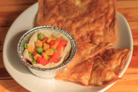 southern flat bread or crispy roti and breakfast on white plate photo
