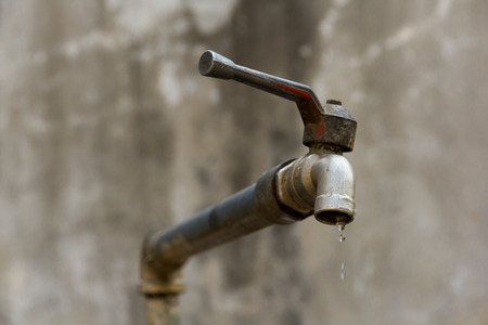 a dripping tap showing water being wasted photo