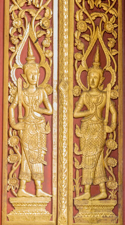 The Carving wood on the door at thai temple