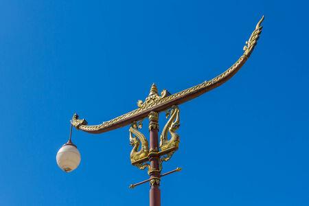 Thai  art  on light pole with blue sky