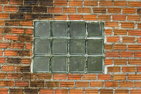 glass brick: optical glass brick on red wall for background