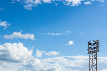 sportlight  mast on Blue sky with big clouds and  free space for your text Stock Photo