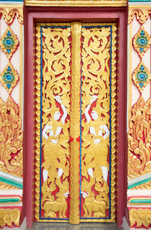 wood carving door: The Carving wood on the door at thai temple