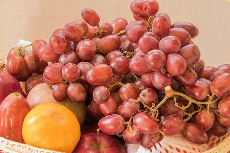 Fresh autumn fruits - rose apple, grapes,orange and apples Stock Photo