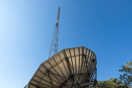 communication tower: communication tower with analog television antenna transmitters Stock Photo