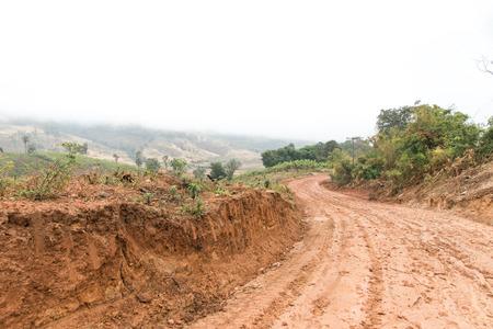 new rural road on season rain  in countryside, Thailand.