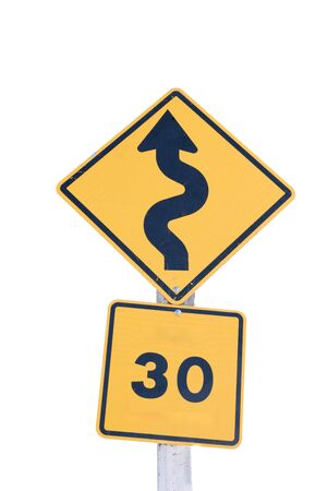 turns: A Traffic sign warns of sharp  turns ahead and  speed  limit on a road