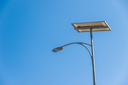 powered: photovoltaic on street lamppost for powered street light on blue sky