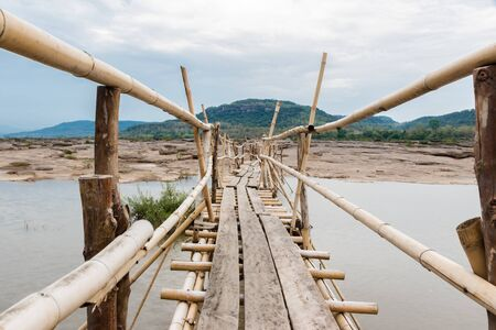 bridge in nature: Bamboo bridge over the Mekong River in summer. Ubon Ratchathani province,Thailand
