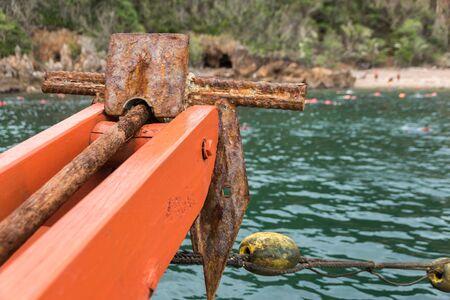 grapnel: Old small rusty anchor for a small boat  folding grapnel anchor