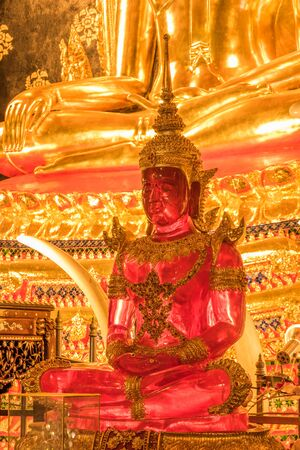 pink buddha among other buddhas in Loei ,Thailand