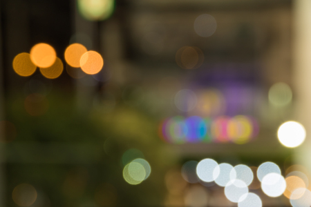 out of town: bokeh background with night lighting in town. out of focus