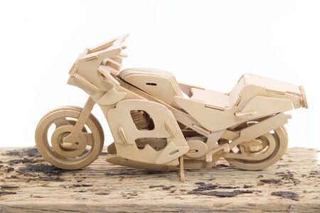 original bike: Motorcycle models made of wood  in side view of white background