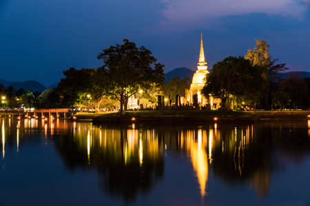 Light show in Buddha Statue at Temple in Sukhothai Historical park , Thailand Stock Photo