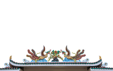 chinese phoenix: Chinese phoenix statue on roof with white background