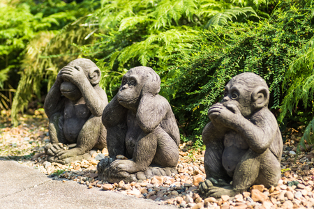 Monkey statues sit,Close it eyes, mouth, ears. focus on middle monkey Stock Photo