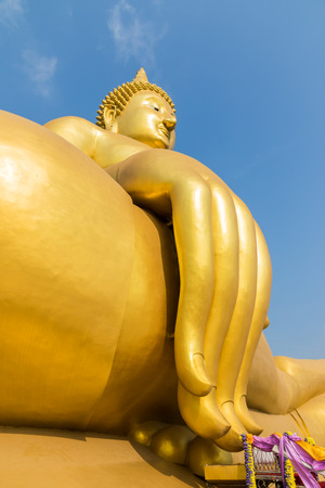big golden buddha on blue sky in Angtong, Thailand