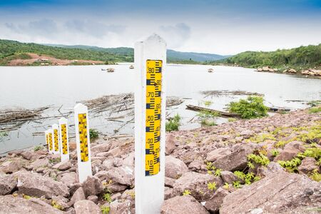 depth gauge: Poles for showing the water level in the reservoir is used to calculate the rate of release of water to farmers.